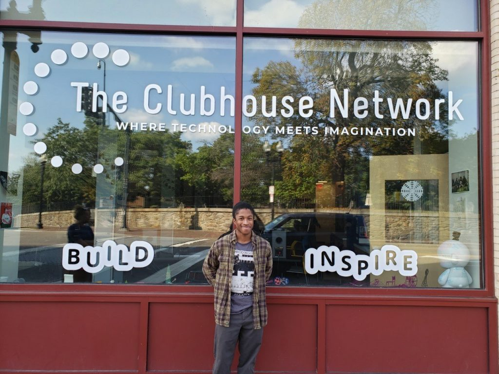 Flagship Alum Jordan Daley Stands in front of The Flagship Clubhouse in Roxbury, MA