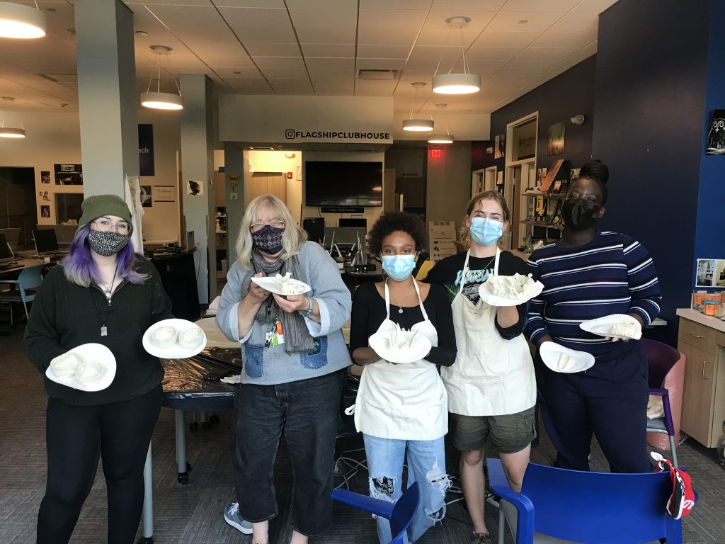 """Members work with clay, reflecting and reacting to the prompt """"what I love about me"""" at Girls Day, taking place alternating Wednesdays"""